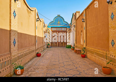 YAZD, IRAN, OCTOBER 18, 2017: The medieval edifice of Yazd Bar Association boasts traditional narrow courtyard, decorated with tiled patterns, on Octo - Stock Photo