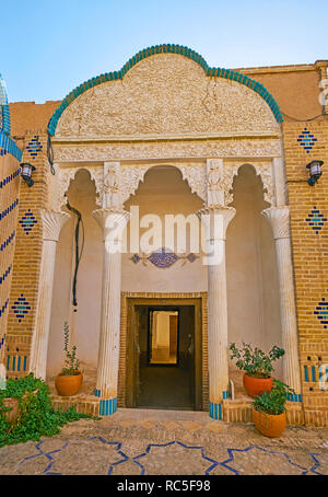 YAZD, IRAN, OCTOBER 18, 2017: The ornate white stucco porch of the mansion of Yazd Bar Association, located in old town, on October 18 in Yazd. - Stock Photo