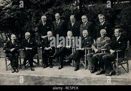 """'Imperial Conference Meets in London', May 1943, (1945). Group portrait of leaders of the four semi-independent Dominions and British politicians at a meeting during the Second World War. Front row, left to right: Clement Attlee, New Zealand Prime Minister Peter Fraser, Canadian Prime Minister William Lyon Mackenzie King, British Prime Minister Winston Churchill, Australian Prime Minister John Curtin, South African Prime Minister Jan Smuts, Anthony Eden. Standing: Lord Woolton, Oliver Lyttelton, Sir John Anderson, Ernest Bevin and Herbert Morrison. From """"The Life and Times of Winston Chur - Stock Photo"""