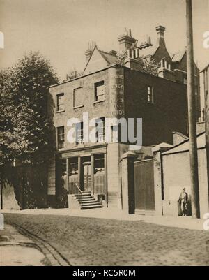 """""""The Grenadier"""" in Wilton Mews, Where Coachmen Drink No More', c1935. Public house in Belgravia, London, built in 1720 as the officers' mess for the senior infantry regiment of the British army, the 1st Regiment of Foot Guards. The building was located in a courtyard of their barracks. It opened to the public in 1818 as The Guardsman, and was renamed in honour of the Grenadier Guards' actions in the Battle of Waterloo (1815). It was frequented by the Duke of Wellington and King George IV. From """"Wonderful London, Volume 3"""", edited by Arthur St John Adcock. [The Fleetway Hous - Stock Photo"""