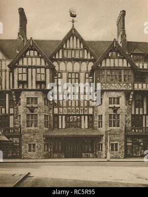 """'Part of Liberty's Tudor Building in Great Marlborough Street', c1935. Liberty's department store in Great Marlborough Street, central London, was designed in mock Tudor style by E Stanley Hall and opened in 1924. The 4-foot weather vane is a model of the pilgrims' ship 'Mayflower'. From """"Wonderful London, Volume 3"""", edited by Arthur St John Adcock. [The Fleetway House, London, c1935] - Stock Photo"""