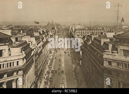 "'On The Roof of Bush House, Looking From Kingsway Towards The Northern Heights', c1935. View from the top of the BBC building at the southern end of Kingsway in central London. Bush House was used to broadcast BBC programmes between 1941 and 2012. To the left is Shell House, and opposite, with wireless telegraphy installation on the roof, is Adastral House, headquarters of the Air Ministry. In the distance is St Pancras Station. From ""Wonderful London, Volume 2"", edited by Arthur St John Adcock. [The Fleetway House, London, c1935] - Stock Photo"