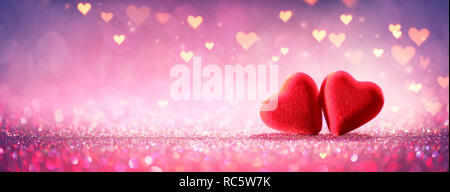 Two Hearts On Pink Glitter In Shiny Background - Valentine's Day Concept - Stock Photo