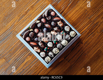 Handmade chocolates or candies in the box. This chocolate gift are delicious, natural, organic luxury and healthy. - Stock Photo