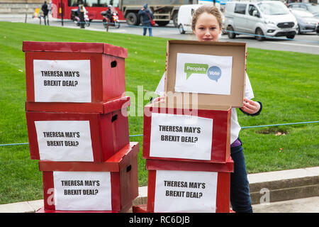 """London, UK. 14th January, 2019. 'Deal or No Deal' boxes reading """"Theresa May's Brexit deal?"""" on the outside and """"People's Vote"""" on the inside brought by activists from People's Vote UK to Parliament Square. A vote on Prime Minister Theresa May's proposed Brexit withdrawal agreement is due to be held in the House of Commons on 15th January. Credit: Mark Kerrison/Alamy Live News - Stock Photo"""