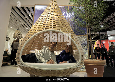 14 January 2019, North Rhine-Westphalia, Köln: Models lie in a basket for the terrace (manufacturer: Dedon). The International Furniture Fair imm cologne will take place from 14 - 20 January 2019. Photo: Oliver Berg/dpa - Stock Photo