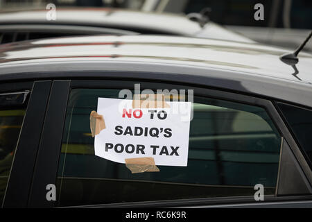 London, UK - 14 Jan, 2019: A protest sign attached to a minicab blocking the road outside TFL offices in a demonstration against congestion charges. Credit: Kevin J. Frost/Alamy Live News - Stock Photo