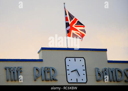 Weymouth. 14th January 2019. A  British Union flag ( Union Jack ) flies in the morning sunshine on Weymouth's Art Deco Pier Bandstand Credit: stuart fretwell/Alamy Live News - Stock Photo