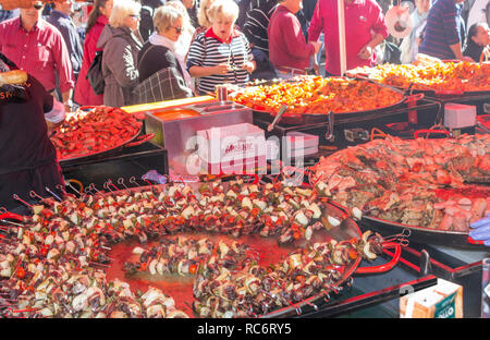 Campillos, Malaga, Spain. Ham and pork products fair. Large pans of sausages, chorizo and other pork related products are served to the many visitors  - Stock Photo