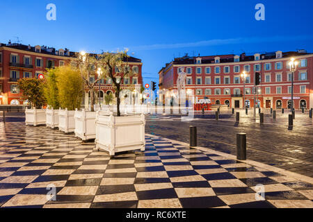 France, Nice, Place Massena, main square in the city centre, view to Fountain of the Sun (Fontaine du Soleil). - Stock Photo