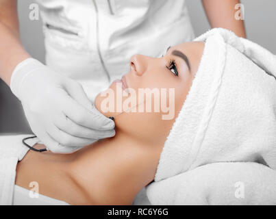 cropped woman face getting facelift , procedure lifting skin - Stock Photo