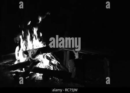 Amazing view of campfire flame in dark with Monochrome effect - Stock Photo