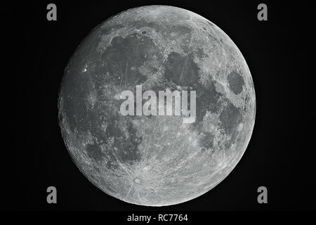 Big shining Moon in growing phase (waxing gibbous), with high details on his grey surface, all in a black background, taken with large newtonian. - Stock Photo