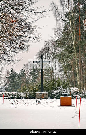 Porvoo, Finland - December 25, 2018: old town cemetery grave yard with big metal cross in winter snow. - Stock Photo
