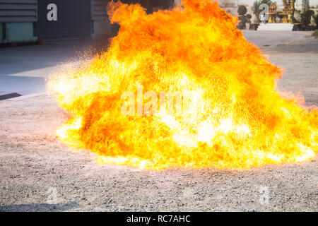 The flame from the oil that rises violently In the fire drill - Stock Photo