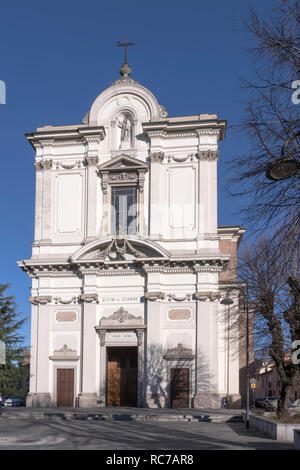 facade view of san Giovanni Battista parish church, shot in bright winter light at Robecco sul Naviglio, Milan, Lombardy, Italy - Stock Photo