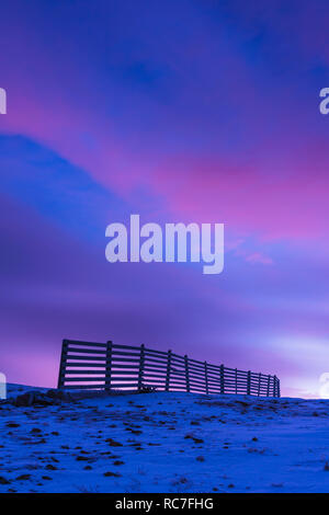 Winter landscape with fence at dusk - Stock Photo