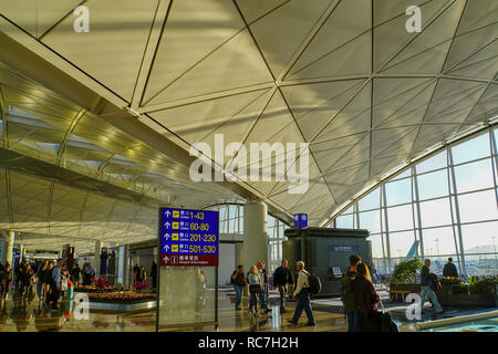 Asia, Southeast, People's Republic of China, Hong Kong, people waiting for the flight at Hong Kong international airport. - Stock Photo