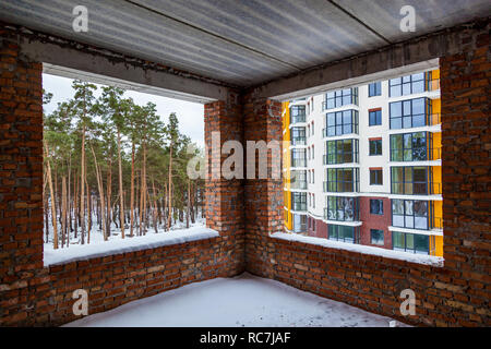 Brick house from a red brick, construction area construction of multi-storey residential buildings - Stock Photo