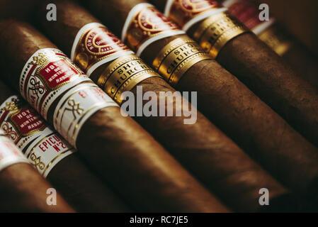 Cuban Cigar brands in a humidor. - Stock Photo
