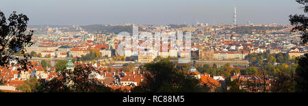 Prague - The panorama of the city with the Charles bridge and the Old Town  in evening light. - Stock Photo