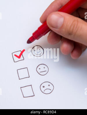 Human hand, tick placed on excellent check box. Customer service, satisfaction, survey form - Stock Photo