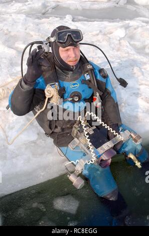 Diver, preparing for subglacial diving, ice diving, in the frozen Black Sea, a rare phenomenon, last time it occured in 1977 - Stock Photo