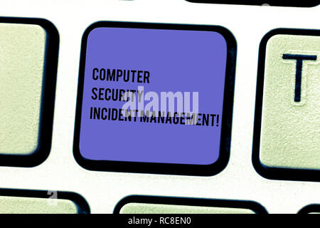 Writing note showing Computer Security Incident Management. Business photo showcasing Safe cyber technology analysisaging Keyboard key Intention to cr - Stock Photo