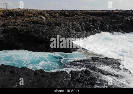 Bay with lava rocks in Buracona, Sal, Cape Verde, Africa - Stock Photo