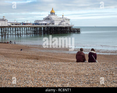 A view of the beach, and pier on the seafront at the south coast seside resort town of Eastbourne East Sussex UK in winter - Stock Photo