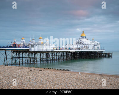 Eastbourne Pier in muted colours in winter at dusk, Eastbourne East Sussex UK - Stock Photo