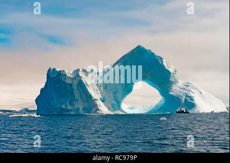 Natural arch carved in an iceberg, Antarctic Sound, Antarctic Peninsula, Antarctica Stock Photo