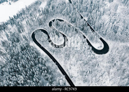 Severe winter weather on roads trough the mountain passes of the Carpathian Mountains - Stock Photo