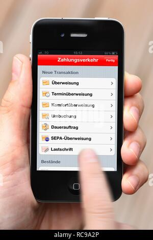 Iphone, smartphone, app on the screen, online banking, Sparkasse - Stock Photo