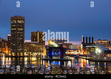 Baltimore Skyline at twilight, National Aquarium (with neon wave), and boats in marina, Inner Harbor, Patapsco River, Baltimore, Maryland USA - Stock Photo