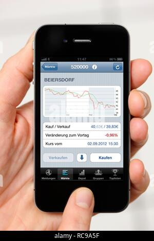 Iphone, smart phone, information on stock prices, app on the screen - Stock Photo