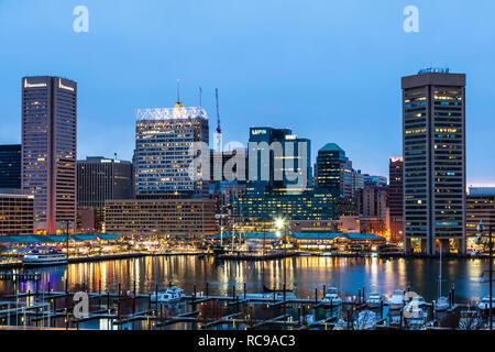 Baltimore Skyline at twilight and boats in marina, Inner Harbor, Patapsco River, Baltimore, Maryland USA - Stock Photo