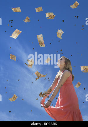 jugendliches Mädchen empfängt Geldregen | young female teenager receiving money rain - Stock Photo
