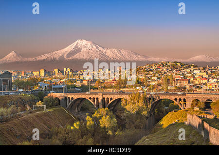 Old arched bridge with the peaks of the Ararat mountain in Yerevan, Armenia. - Stock Photo