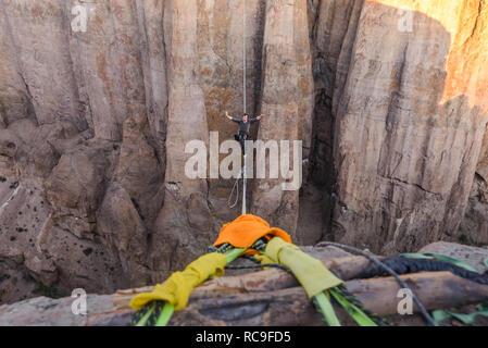 Highlining in Piedra Parada, south Patagonia, Argentina - Stock Photo