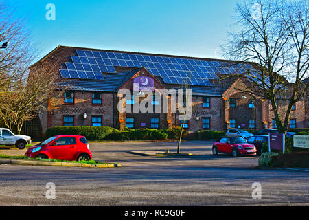 The front elevation of the Pantruthyn Farm Premier Inn hotel just off Junction 35 of the M4 near Bridgend. Numerous solar panels on roof. - Stock Photo