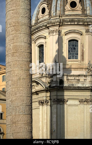 Rome, Italy, 11/18/2012: in close up on the left a section in detail of the 'trajan column', on the right the church of 'Santissimo nome di maria' - Stock Photo