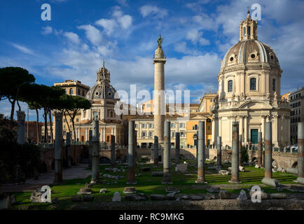 Rome, Italy, 11/18/2012: in close up archaeological ruins of the 'piazza del foro di traiano', in the center of the image the 'trajan column', on the  - Stock Photo