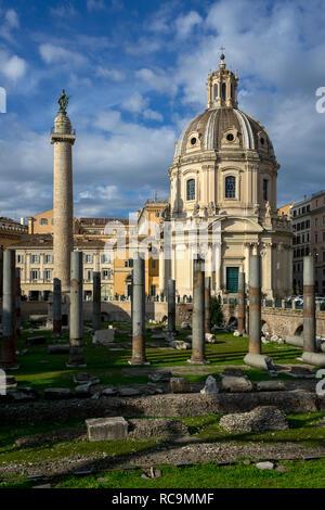 Rome, Italy, 11/18/2012:'piazza del foro di traiano' in close up, on the left   the Trajan column, on the right the church 'Santissimo nome di Maria' - Stock Photo