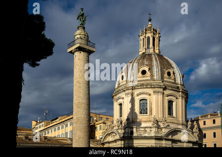 Rome, Italy, 11/18/2012:  the 'trajan column' in close up on the left, on the right the church of 'Santissimo nome di maria' - Stock Photo