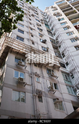 Apartment Building with Bamboo Scaffold - Stock Photo