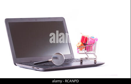 boxes in shopping cart on the emptied laptop screen - Stock Photo