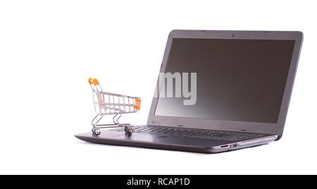 empty shopping cart on laptop - Stock Photo