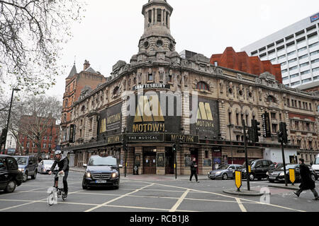 Shaftesbury Theatre featuring Motown the Musical on Shaftesbury Avenue and Brompton bicycle in traffic in London WC2 England UK    KATHY DEWITT - Stock Photo