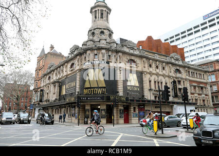 Cyclists riding bikes on the road past Shaftesbury Theatre featuring Motown the Musical on Shaftesbury Avenue in London WC2 England UK    KATHY DEWITT - Stock Photo